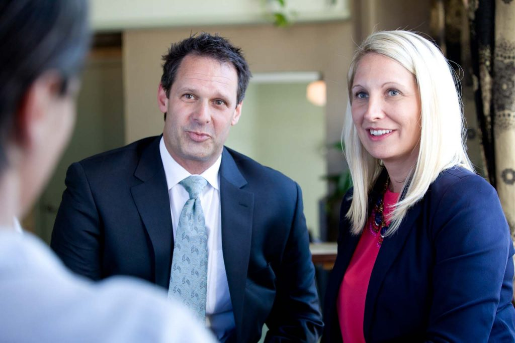 Image of Asheville DIvorce Lawyers, Patrick McCroskey and Janet Amburgey, at a downtown Asheville location. Both are Business North Carolina Legal Elite Listees in 2018