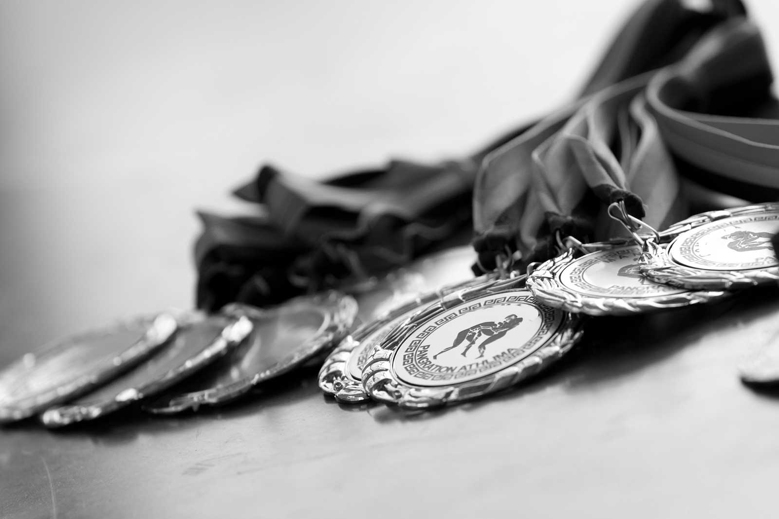 Black and white image of Olympic medals representative of awards.