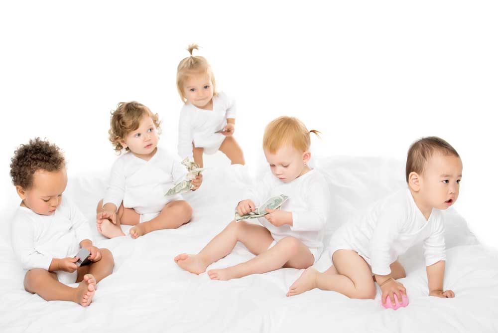 Image of babies from all races denoting adoption.