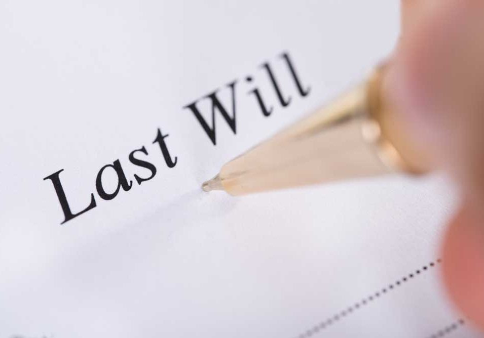 """Image of formal """"Last Will"""" document with pen."""