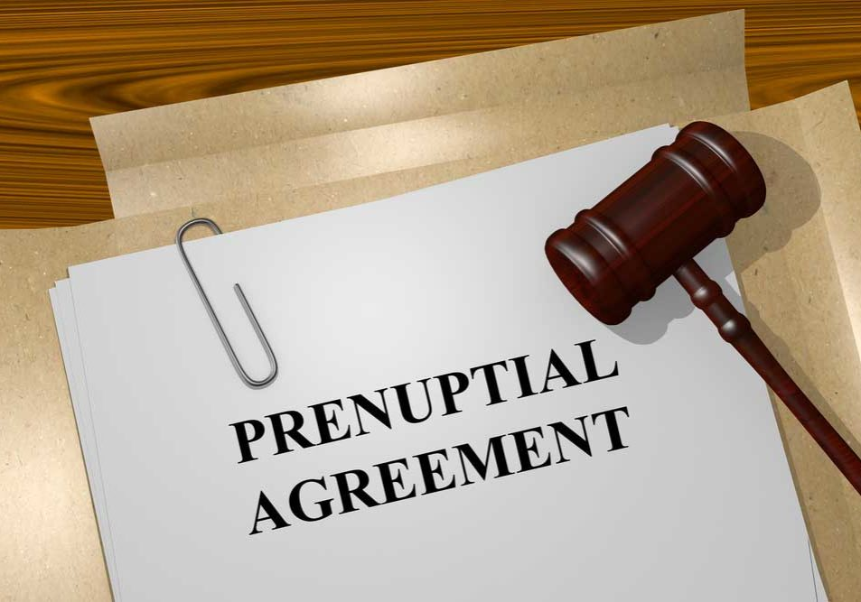 Image of a file folder attoped with a gavel labeled Prenuptial Agreement.