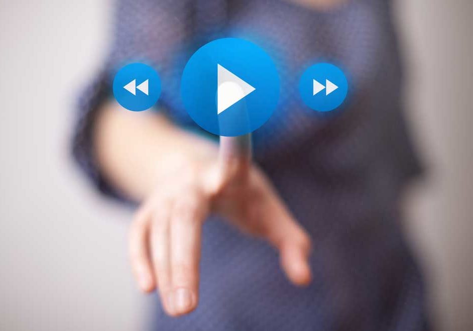 Image depicting playing a video with play button, rewind and fast forward.
