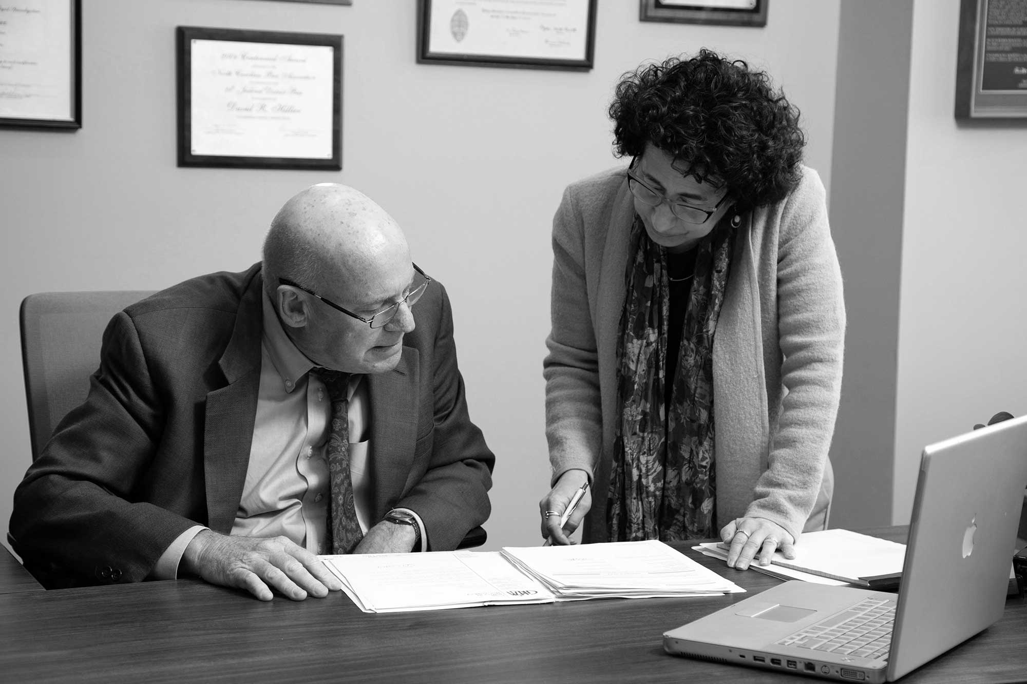 David Hillier with his long time assistant, Idelle David, reviewing a filing
