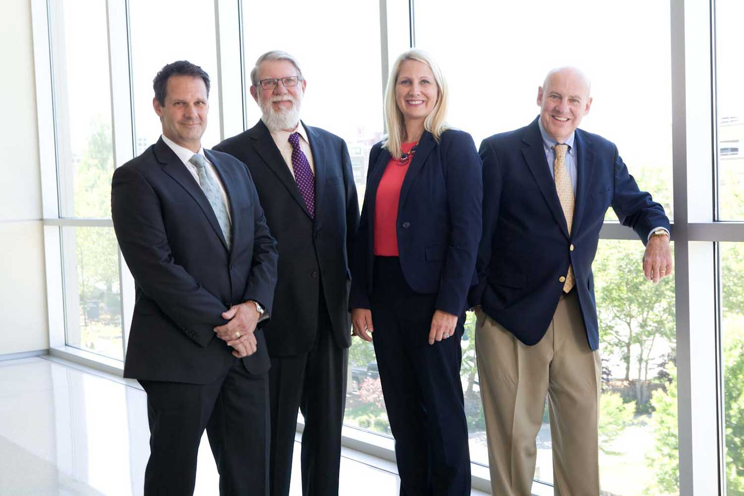 Image of Attorneys Patrick McCroskey, Howard Gum, Janet Amburgey, and David Hillier taken on location at the Buncombe County Justice Center in 2017