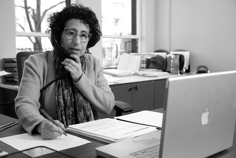 Black and White image of Idelle David in her office at 47 North Market Street.