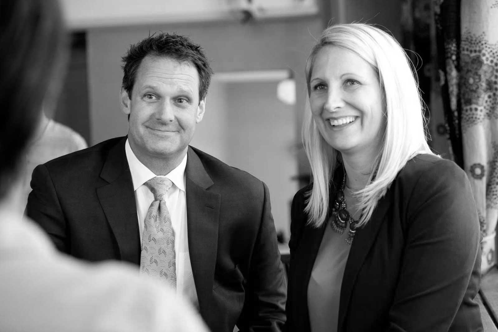 Black and white image of attorneys Patrick McCroskey and Janet Amburgey meeting with a client.