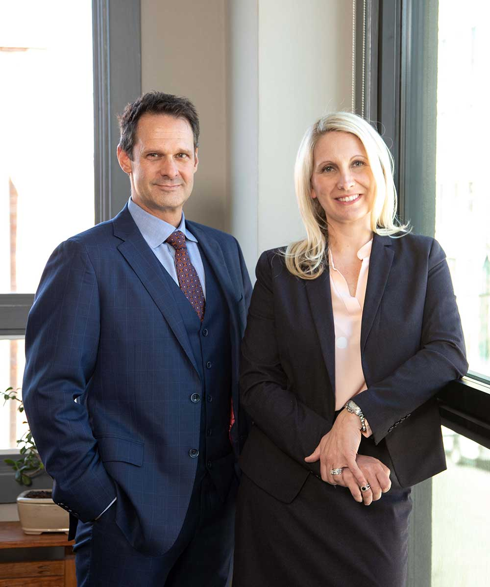 Image of Patrick McCroskey & Janet Amburgey in their offices in historic downtown Asheville