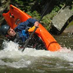 Image of Patrick McCroskey taken in 2012 Kayaking in white water navigating a plunge.