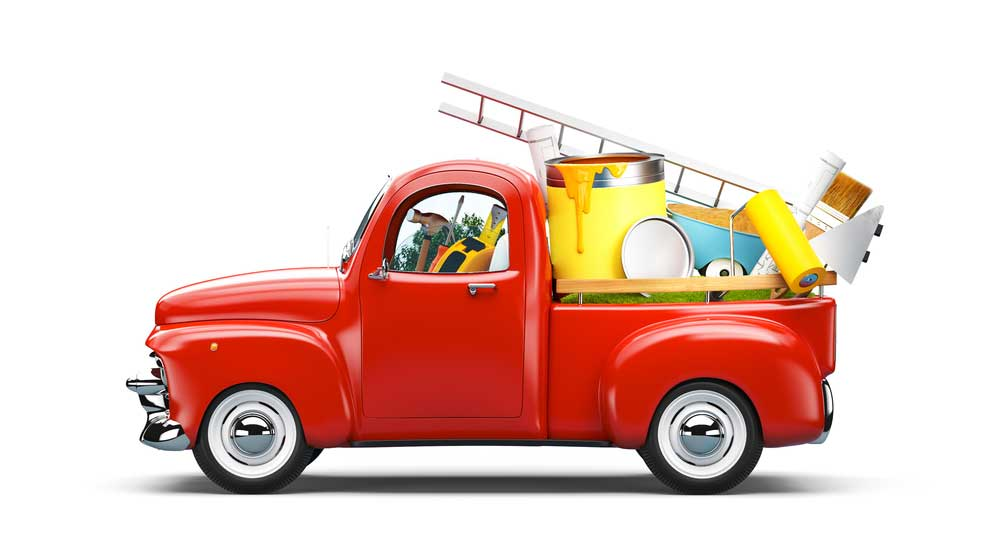 Image of a toy, possibly a model, of a bright red antique truck filled with colorful tools depicting the idea of property belonging to a family that might be titled by a business or third party