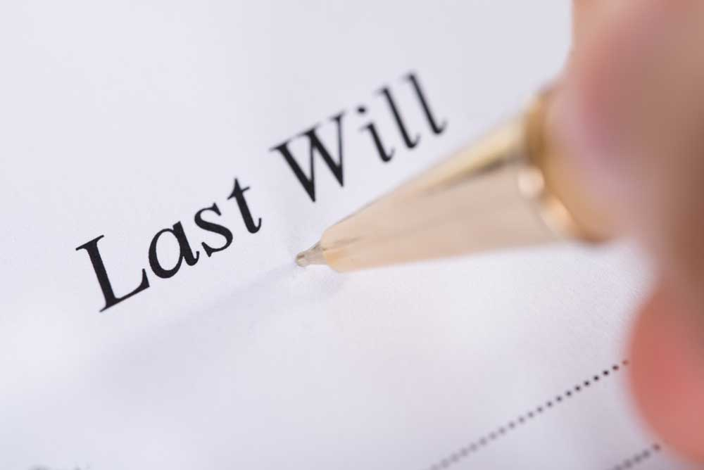 "Image of formal ""Last Will"" document with pen."