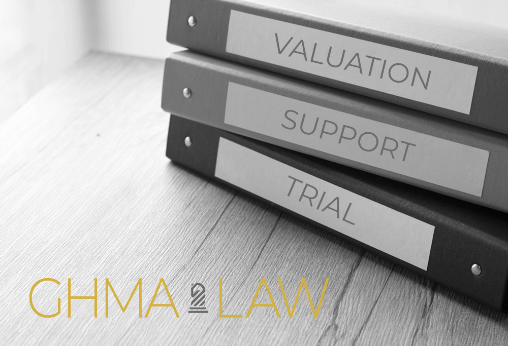 Image of notebooks on a desk labeled Valuation, Support & Trial, denoting organization and preparedness for trial of matters that could not be settled at Mediation.