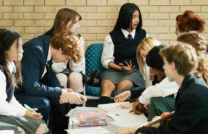 Image of a group of private school students wearing school uniforms in a study session.